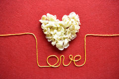 Valentines day card - heart made of ribbon on red background Stock Image