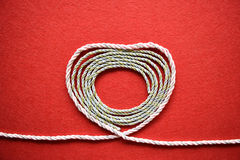 Valentines day card - heart made from wire on red background Royalty Free Stock Photo