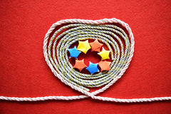 Valentines day card - heart made from wire on red background Stock Photos