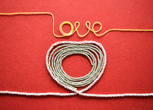 Valentines day card - heart made from wire on red background Royalty Free Stock Photography