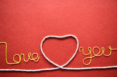 Valentines day card - heart made from wire on red background Stock Photo