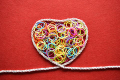 Valentines day card - heart made from wire on red background Royalty Free Stock Image