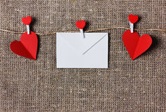 Valentines day card with hearts on a sacking or hessian or burlap background. Love message on Valentines day, empty space for text Stock Photography