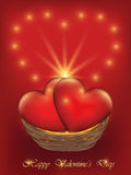 Valentines Day card with hearts in a wicker basket. Happy Valentine`s Day card with two hearts in a wicker basket. Red background with golden sparkle Royalty Free Stock Photos