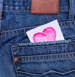 Valentines day card in jeans pocket. Valentine's day card in jeans pocket Royalty Free Stock Image
