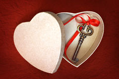 Valentines Day card: Key in heart shaped gift box Royalty Free Stock Photography