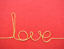 Valentines day card - love made from wire on red background Royalty Free Stock Photography