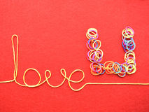 Valentines day card - love made from wire on red background Stock Image
