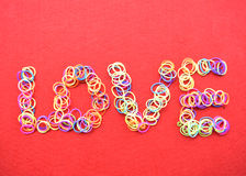 Valentines day card - love made from wire on red background Royalty Free Stock Photo