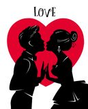 Valentines Day Card. Lovers kiss. Man and woman kissing on background of red heart. Man in tuxedo, woman in ball gown. Silhouettes of loving couple Stock Photo
