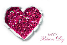 Valentines Day Card. Paper Hole Ripped in shape of Heart. With Glitter Hot Pink background inside Stock Photo