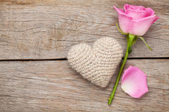Valentines day card with pink rose and handmaded toy heart Royalty Free Stock Photo