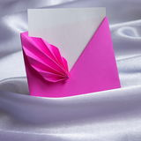 Valentines Day Card : Romantic letter - Stock Phot. Valentines Day Card - Pink Romantic letter : beautiful origami Envelope on White Silk Background royalty free stock photo