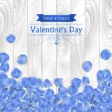 Valentines day card with rose blue petal. On a white wooden background Royalty Free Stock Photos