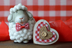 Valentines Day card with sheep toy and heart Stock Image