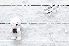 Valentines day card, snowflakes toy bear heart on white wooden romantic winter holiday background, top view, copy space Stock Photography