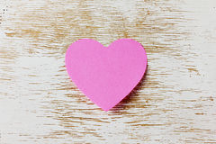 Valentines day card with sticky note in the shape of a heart on a wooden background Stock Photography