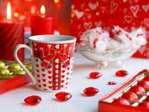 Valentines Day Card - Stock Photo. Valentines Day Card -hearts, golden chocolates, cups and red candles Royalty Free Stock Images