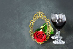 Valentines Day card: Two glasses of red wine, red rose and vintage frame Royalty Free Stock Photos