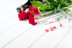 Valentines day cards. Bouquet of red roses on white wooden board. Selective focus. Space for text. Royalty Free Stock Images