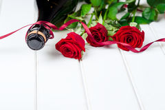 Valentines day cards. Bouquet of red roses on white wooden board. Selective focus. Space for text. Royalty Free Stock Image