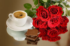 Valentines Day Celebration. With a bouquet of fresh roses, chocolate and coffee royalty free stock image