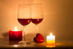 Valentines Day Celebration. Romantic Valentines Day Celebration with candles and wine royalty free stock image