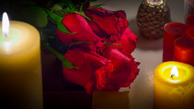Valentines Day Celebration. Romantic Valentines Day Celebration with roses, sweets and candles royalty free stock photo