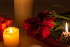 Valentines Day Celebration. Romantic Valentines Day Celebration with roses, sweets and candles royalty free stock images