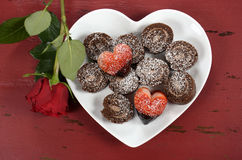 Valentines Day chocolate dipped heart shaped strawberries with chocolate roulade swiss roll. Happy Valentines Day chocolate dipped heart shaped strawberries with Stock Photos