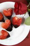 Valentines Day chocolate dipped heart shaped strawberries closeup Royalty Free Stock Photography