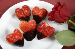 Valentines Day chocolate dipped heart shaped strawberries Royalty Free Stock Images