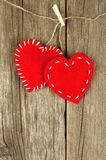Valentines Day cloth hearts on wood Royalty Free Stock Photos