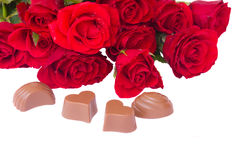 Valentines day cocept. Red roses bouquet with chocolate hearts royalty free stock photos