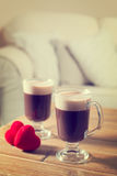Valentines Day Coffees. Two Valentines Day Irish coffees in living room - vintage tone effect Stock Photo