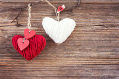 Valentines day colorful hearts over wooden background. Toned, soft focus, copy space. Vintage style Stock Photo