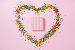 Valentines day composition: gift box with bow, candy and candies Stock Image