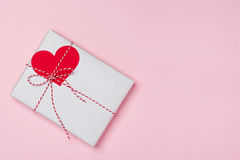 Valentines day composition: gift box with bow and hearts on red Royalty Free Stock Photos