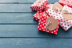 Valentines day composition: gift boxes with bows and hearts. On wooden background Stock Image