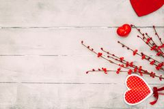 Valentines Day composition. Red hearts, gift box, on wooden background. Love or romantic concept. Flat lay, top view, copy space stock photo