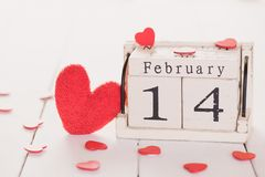Valentines day concept. February 14 text on wooden block royalty free stock photo