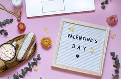 Valentines day concept flat lay with flowers, sweets and a board with text. stock photos