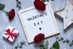 Valentines day concept flat lay on the marble texture. Top view festive card royalty free stock photos