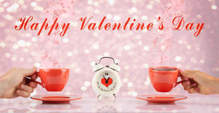 Valentines day concept with hands and cups Royalty Free Stock Image