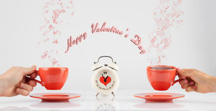 Valentines day concept with hands and cups Stock Photos