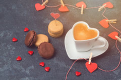 Valentines day concept with heart shape coffee cup and macarons over blackboard Stock Photos