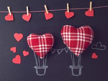 Valentines day concept. With heart shapes as air balloons over chalkboard background stock photo