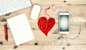 Valentines Day concept. Office Desk Red Heart, Paper, Phone Royalty Free Stock Images