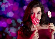 Valentines day concept.  Place for typography. Pretty girl on colorful bokeh background. Valentines day symbol -red hearts. Place for text Stock Photo