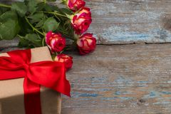 Valentines day concept with red rose flowers and gift box on woo Stock Image